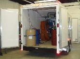 14' Sprintback thermal broke trailer with a Graco E20 spray foam proportioning unit.