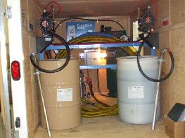 NAP HF2K6 sprayfoam heated hose in rack Graco E20 proportioner unit Donaldson variable flow air dryer Rolair Compressor Husky 1040 drum pumps