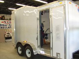Side door entry allows easy access to Graco H-25 spray foam proportioning unit and spray foam equipment.
