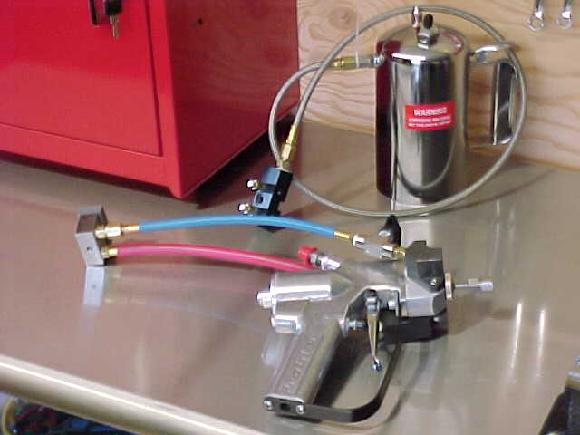Solvent pot and spray gun with AB Block Assembly.